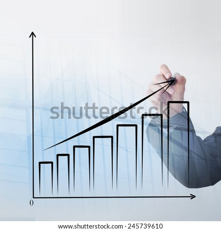 Young businessman hand drawing a graphic  - stock photo