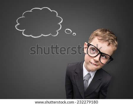 Young  businessman has an idea. Thinking bubble on grey background - stock photo