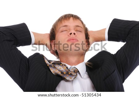 Young businessman has rest in armchair, isolated on white background. - stock photo
