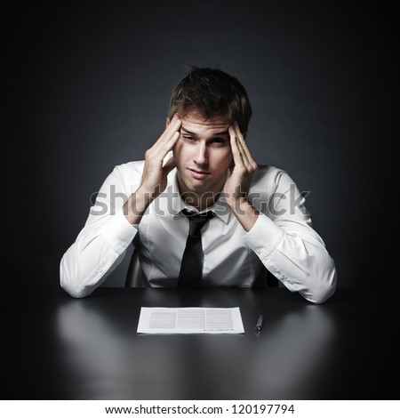 Young businessman has the headache - stock photo