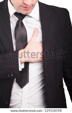 Young businessman having some heart pain - stock photo