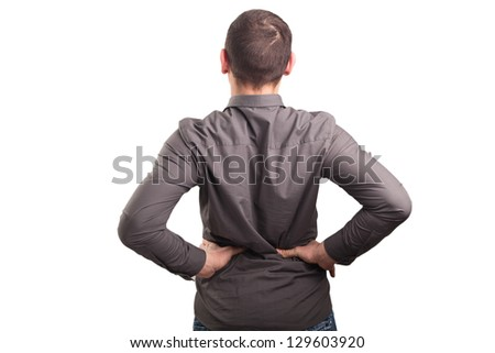 Young businessman having some lower back pain - stock photo
