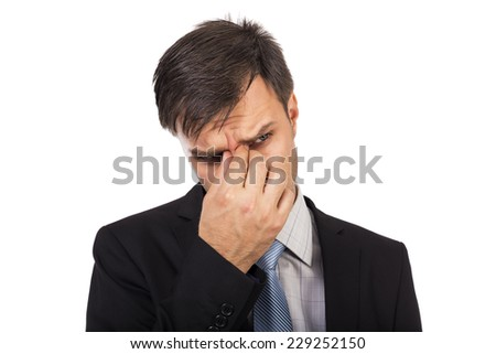 Young businessman having terrible  headache isolated on white background - stock photo