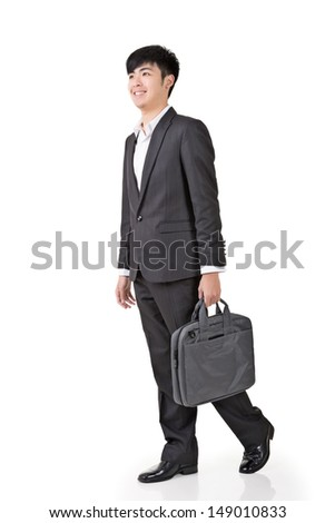 Young businessman hold briefcase and walk, full length portrait isolated on white background.