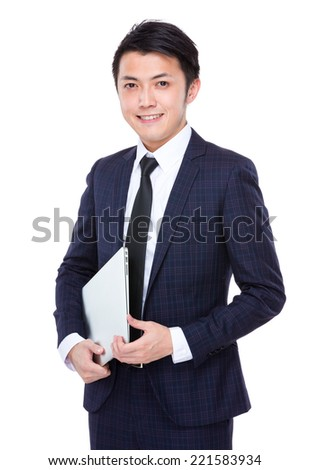 Young businessman hold laptop