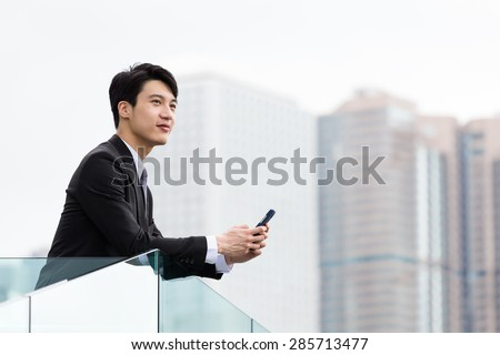 Young businessman hold with cellphone at outdoor