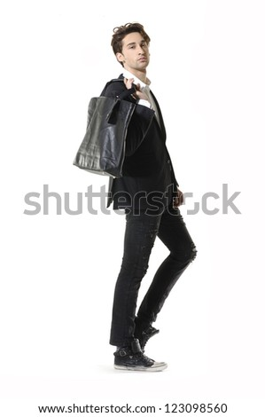 young businessman holding a bag posing on white background - stock photo