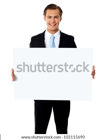 Young businessman holding a blank billboard against white background