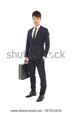 young businessman holding a briefcase and hand in his pocket - stock photo