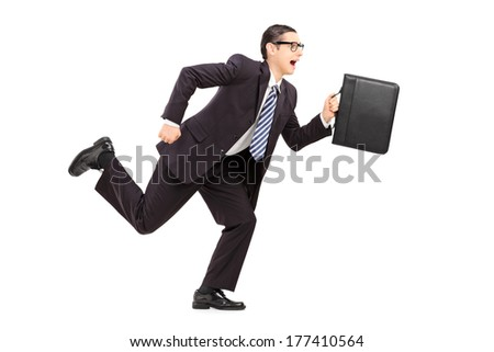 Young businessman holding a briefcase and running isolated on white background