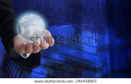 Young businessman holding a digital earth in his hand