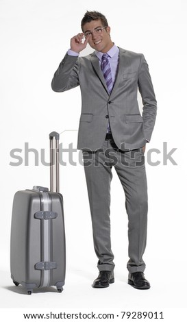 Young businessman holding a luggage on white background. Young traveler businessman on white background. - stock photo
