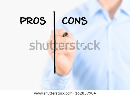 Young businessman holding a marker and writing pros and cons comparison concept for weigh all arguments. Isolated on white background. - stock photo