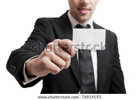 Young businessman holding a personal card on the hand, isolated over a white background - stock photo