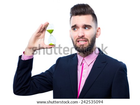 Young businessman holding a sand clock - stock photo