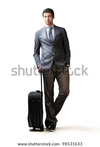 Young businessman holding a suitcase
