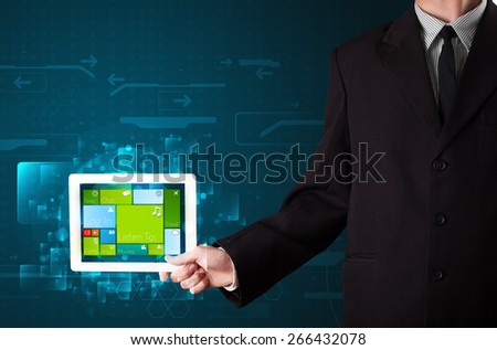 Young businessman holding a tablet with modern software operational system