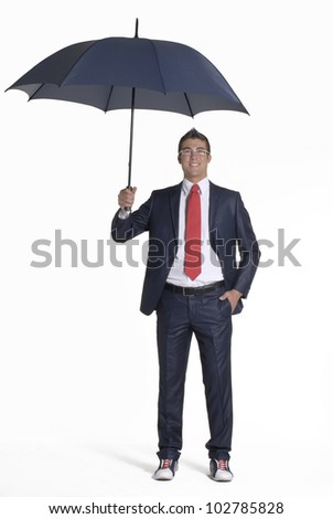 Young businessman holding an umbrella. - stock photo