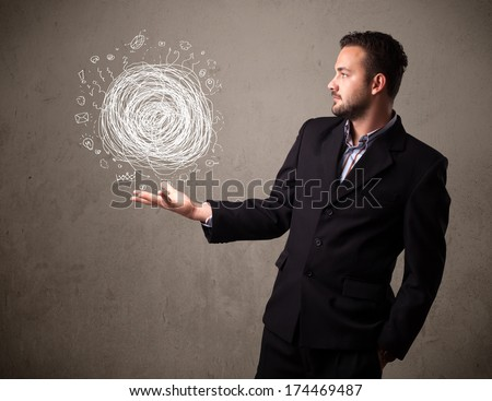 Young businessman holding chaos concept in his hand