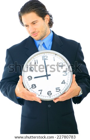 young businessman holding clock showing 9 o'clock. concept for time, working hour, or start of working