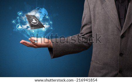 Young businessman holding cloud technology in his hand - stock photo