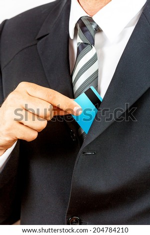 Young businessman, holding credit card, isolated on white background. - stock photo