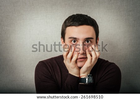 Young businessman holding head in his hands - stock photo