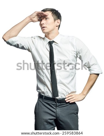 Young businessman holding his hand at forehead and looking forward isolated on white background - stock photo