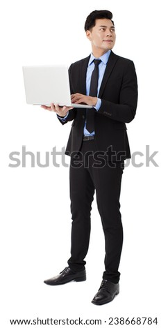 young businessman holding laptop and isolated on white