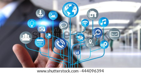 Young businessman holding modern digital electronic circuit with icons in his hand '3D rendering'