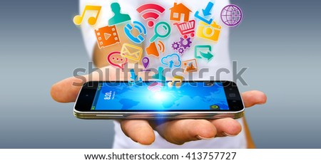 Young businessman holding modern digital icon application over his mobile phone