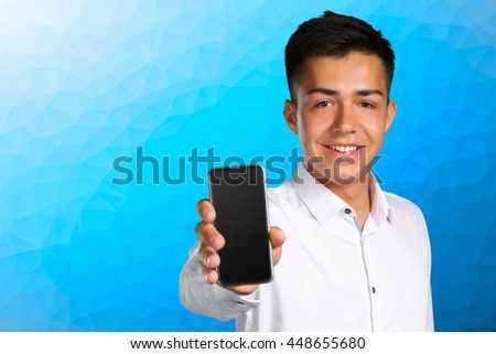young businessman holding smartphone with blank screen  - stock photo