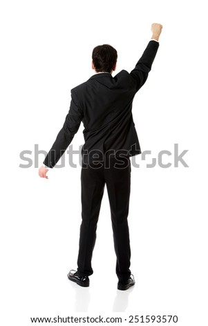 Young businessman holding something big in hands. - stock photo