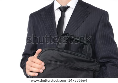 Young businessman holding suitcase isolated on white - stock photo