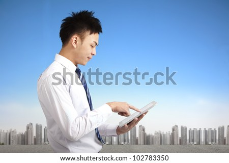 young businessman holding touch pad tablet pc - stock photo