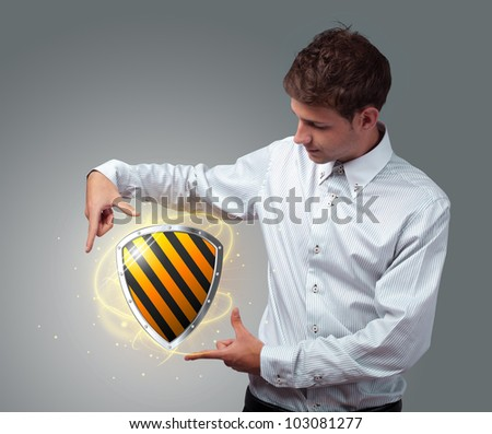 Young businessman holding virtual shield sign