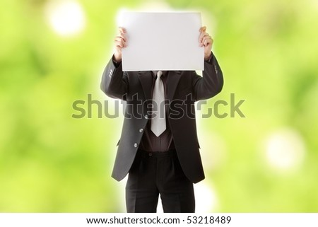 Young businessman holds blank signs. - stock photo