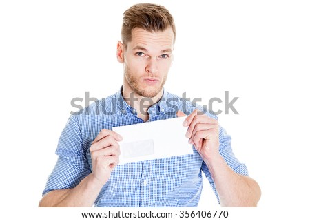young businessman holds in hand an envelope on a white background - stock photo