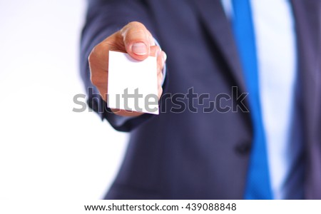 young businessman holds out his hand with a business card for love - stock photo