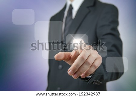 Young businessman in a black suit using virtual technology