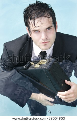 Young Businessman in a suit in the water