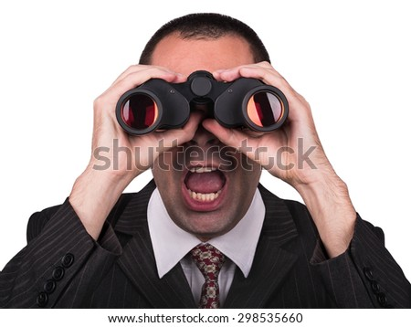 Young businessman in a suit looking through binoculars and opened his mouth in surprise