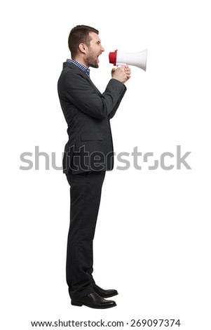 young businessman in black suit screaming at megaphone. isolated on white background