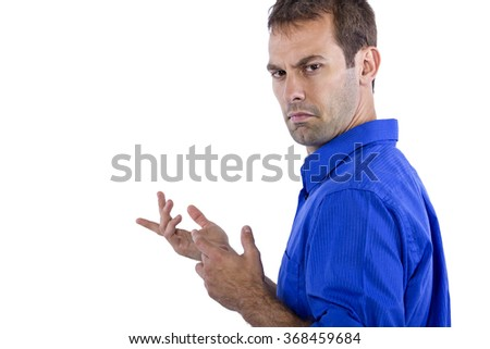 Young businessman in blue collar shirt isolated on a white background. He looks upset at something. - stock photo