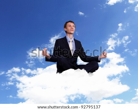 Young businessman in blue suit sitting and praying