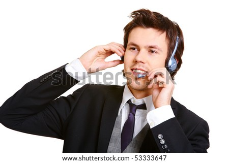 Young businessman in headset consulting client at work - stock photo