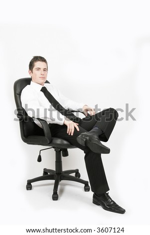 young businessman in his office chair