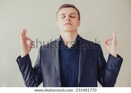 young businessman in meditating - stock photo