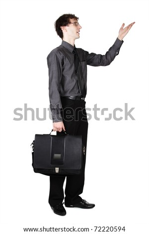 young businessman in office clothes with bag standing and pointing for hand at side, isolated