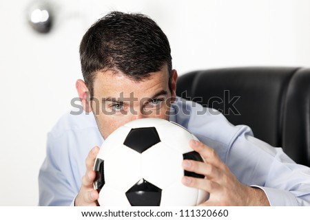 young businessman in office with ball - stock photo